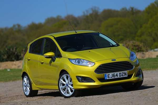Best First Cars for young driver Ford Fiesta Image. Featuring a gold Ford fiesta front on shot.