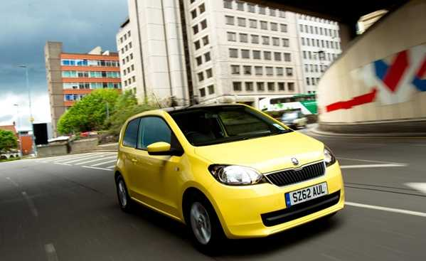 Best First Cars for young driver Ford Fiesta Image. Featuring a Yellow Skoda Citigo front on shot.