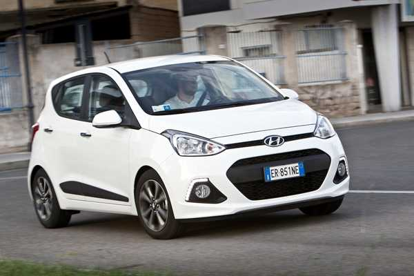 Best First Cars for young driver Ford Fiesta Image. Featuring a white Hyundai i10 front on shot.