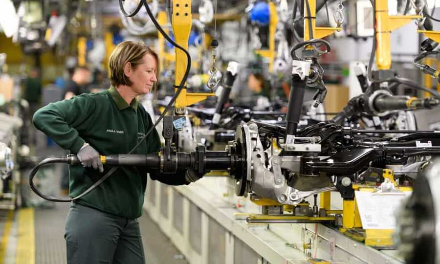 A worker in Jaguar Land Rover's factory