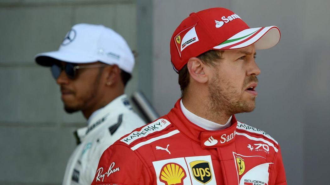 Formula 1's Sebastian Vettel and Lewis Hamilton