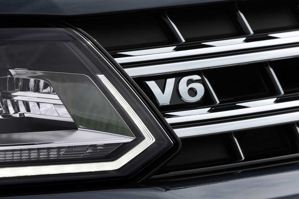 The newer model features a V6 badge on the grille