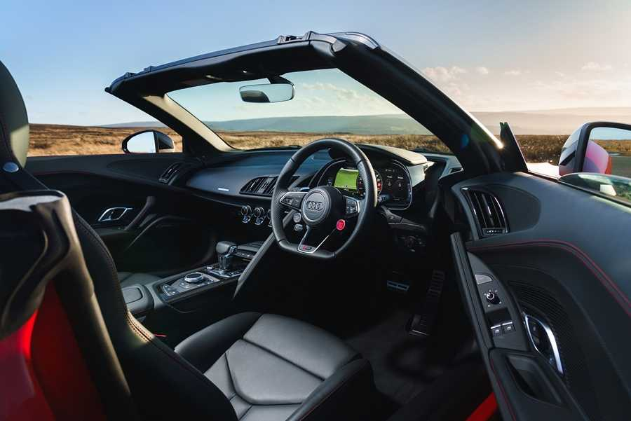 The interior's a blend of leather, red stitching and metallic detailing