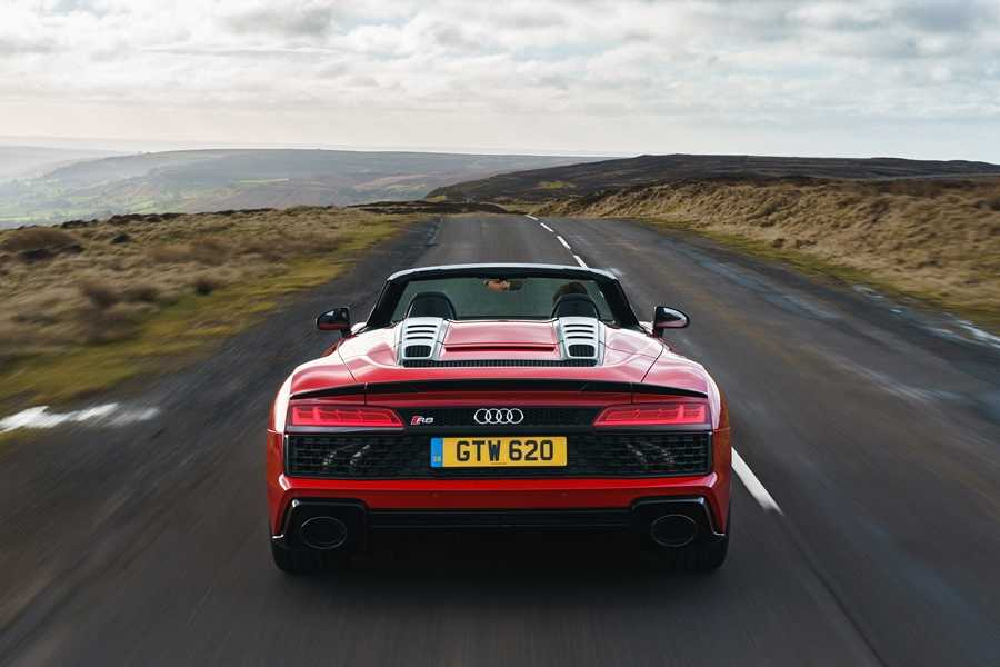 The R8 Spyder's full-width rear grille and oval exhaust tailpipes give it a menacing appearance from behind