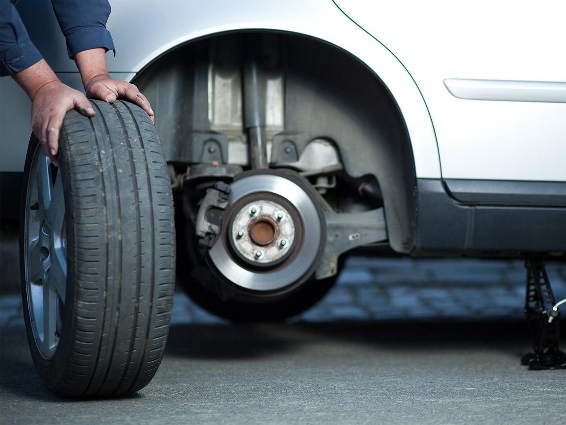 A technician examining a tyre
